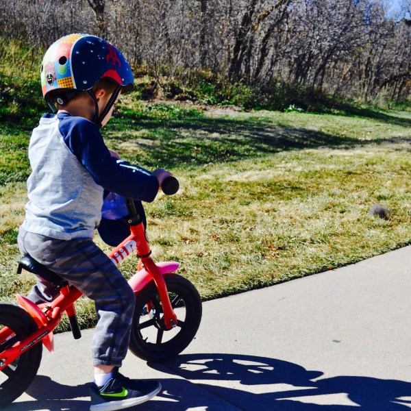My youngest son on his balance bike, cruisin around the park.