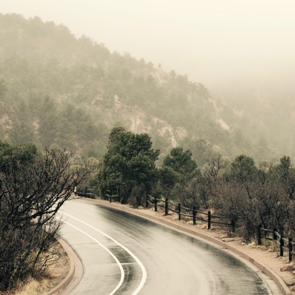 Driving a mountain road in snowy fog