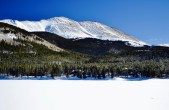 A frozen lake and snowy peak on our drive into Breckenridge.