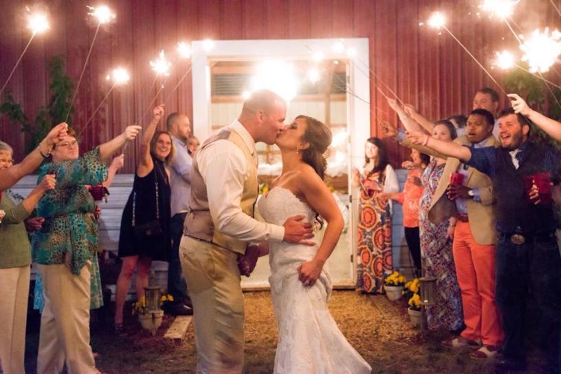 Wedding kiss outside Barn