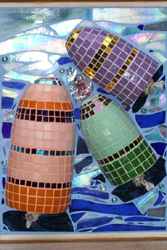A 3-D glass mosaic of three multi-colored buoys floating in the ocean.