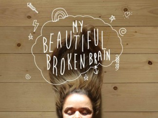 "Image of Lotje Sodderland lying on a wood floor with her hair flowing above her and eyes closed. ""My Beautiful Broken Brain"" is written in a thought bubble with sketched images of rainbows, lines, stars, and lightning."