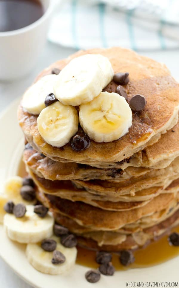Loaded with lots of banana flavor, nutty oats, and gooey chocolate chips; these hearty pancakes are just as healthy as they are indulgent! @WholeHeavenly