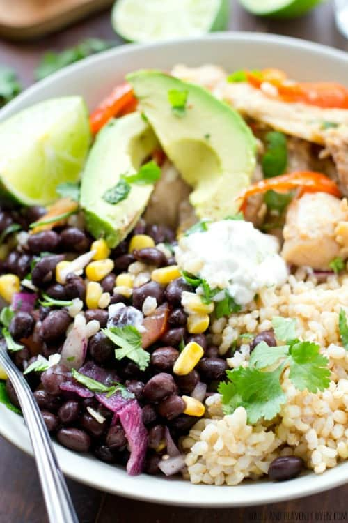 Skip the Mexican take-out and whip up these fun rice bowls that combine all the Mexican-food things you love with chicken fajitas! @WholeHeavenly