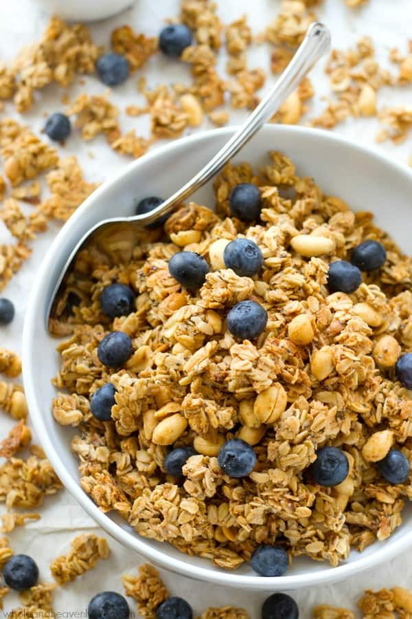 You won't believe that this loaded peanut butter granola is good for you! It's so crunchy, peanut butter-y and addicting, you'll want to eat it all straight from the pan!