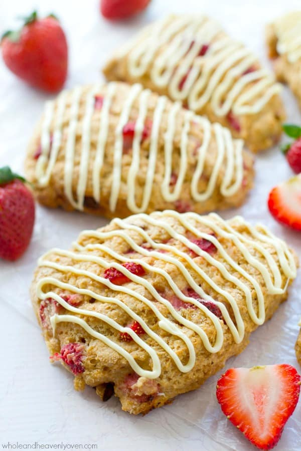 Loaded with big chunks of juicy fresh strawberries and drizzled with melted white chocolate, these ultimately-flaky scones will steal the show at your Mother's Day brunch!