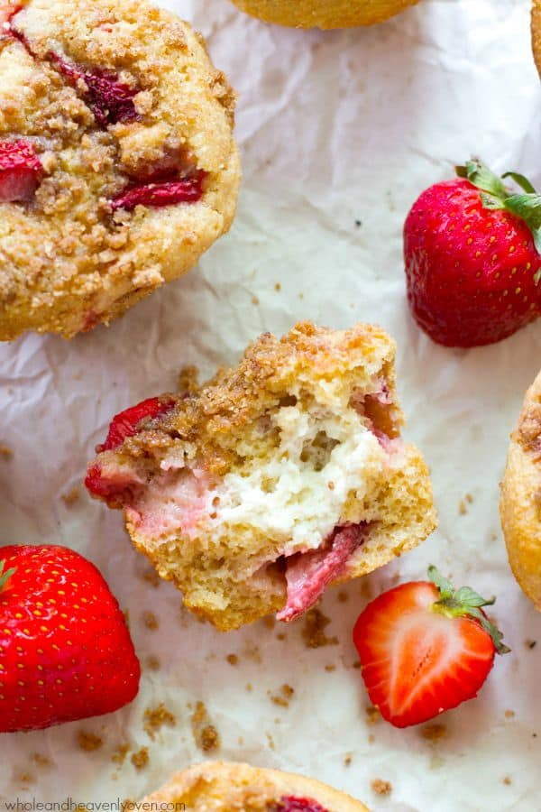 Jam-packed with juicy strawberries, filled with a luscious cheesecake filling and sprinkled with a buttery crumb topping, these ultra-soft muffins are going to become a total summertime favorite!