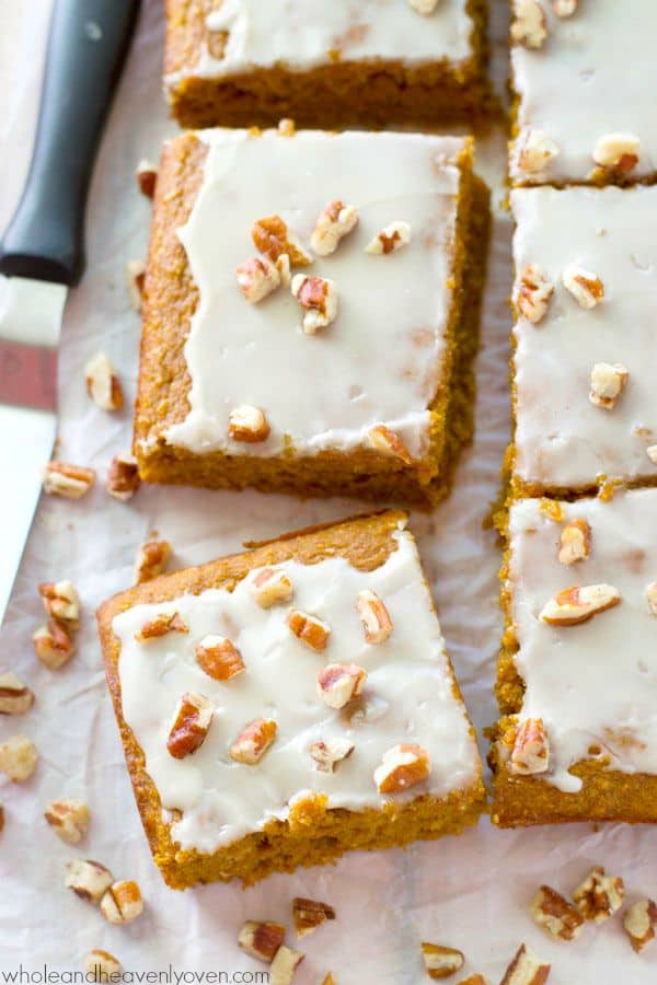 Packed with pumpkin 'n' spices, unbelievably soft inside, and covered with a luscious glaze, these easy cake bars are the perfect way to welcome fall!