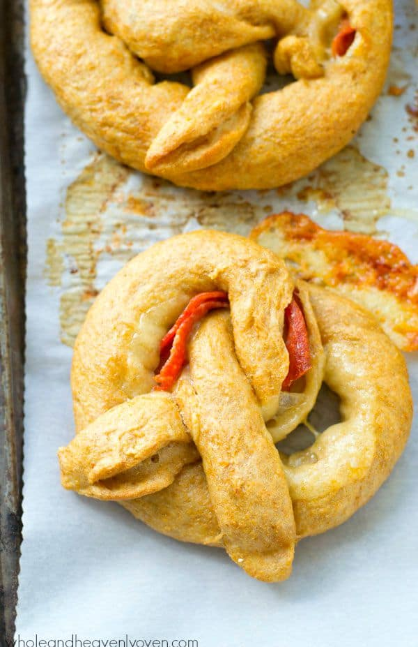 Exploding with gooey cheese and pepperoni slices, these crowd-pleasing soft pretzels are guaranteed to disappear the second you put them out! @WholeHeavenly