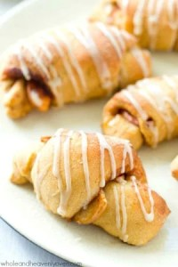 Filled with sugary spiced apples and covered to perfection with glaze, these pillow-soft crescent rolls are a fall brunch favorite that no one will be able to resist!