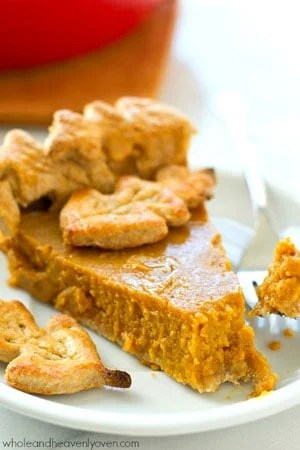 This silky classic Thanksgiving pumpkin pie recipe has been in my family for years and is the easiest and absolute BEST pumpkin pie you'll ever have. Everyone will want seconds!