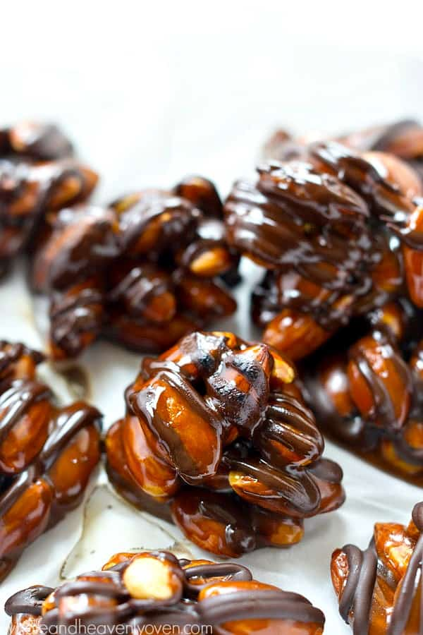 Roasted almonds, dark chocolate, and homemade caramel come together in these dark chocolate caramel almond clusters that whip up in minutes for whenever that sweet tooth craving hits!