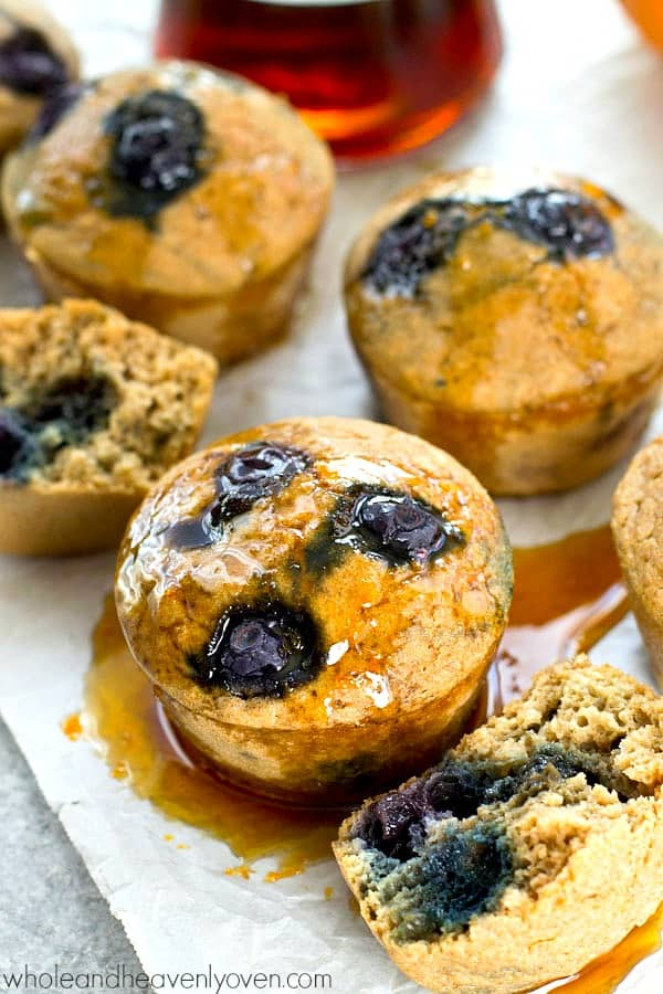 Skip all the time and work involved in pancakes and try these super-easy blueberry pancake muffins! Drizzled with a warm, citrus-y maple syrup, you'll be in pancake heaven!
