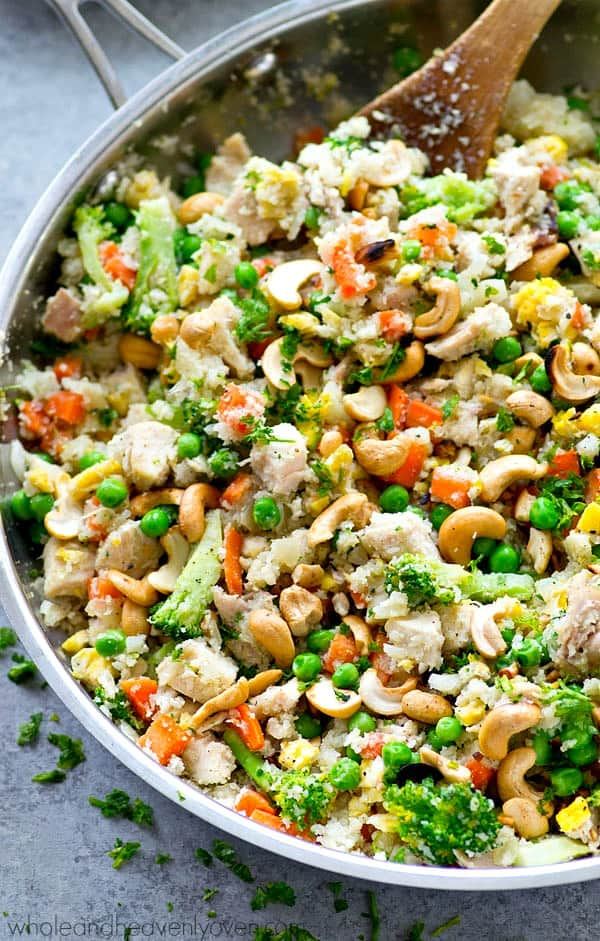 You won't believe that this amazing homemade fried rice is made completely from cauliflower! Loaded with lots of chicken, a rainbow of veggies, and all the fried rice 'fixins.