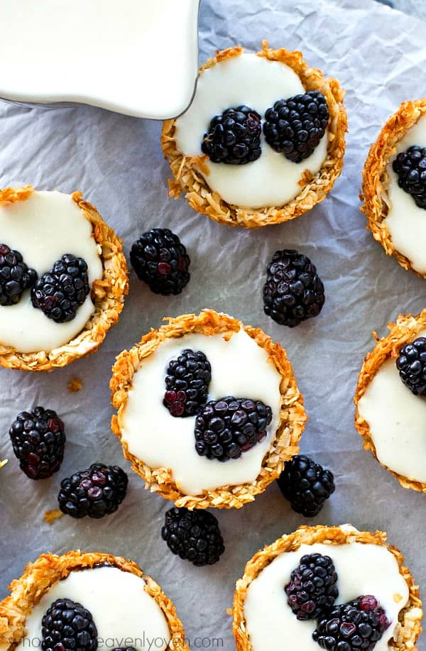A luscious, no-bake cheesecake filling nestled inside little coconut macaroon crusts and topped with lots of fresh blackberries!---these easy tartlets are SUPER-popular at spring gatherings!