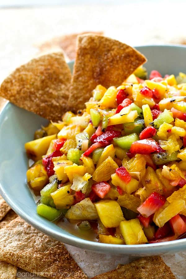 Fresh pineapple gets grilled to sweet 'n' smoky perfection and then tossed with fresh kiwi, strawberries, and orange for one killer summer fruit salsa!---Don't forget the cinnamon tortilla chips!