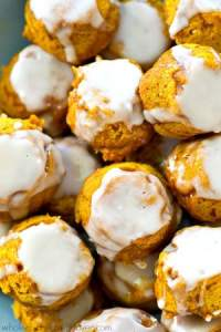 These pillow-soft pumpkin spice donut holes are covered in tons of vanilla glaze and perfect for the upcoming fall days!---So easy to mix up and only 51 calories per donut hole.