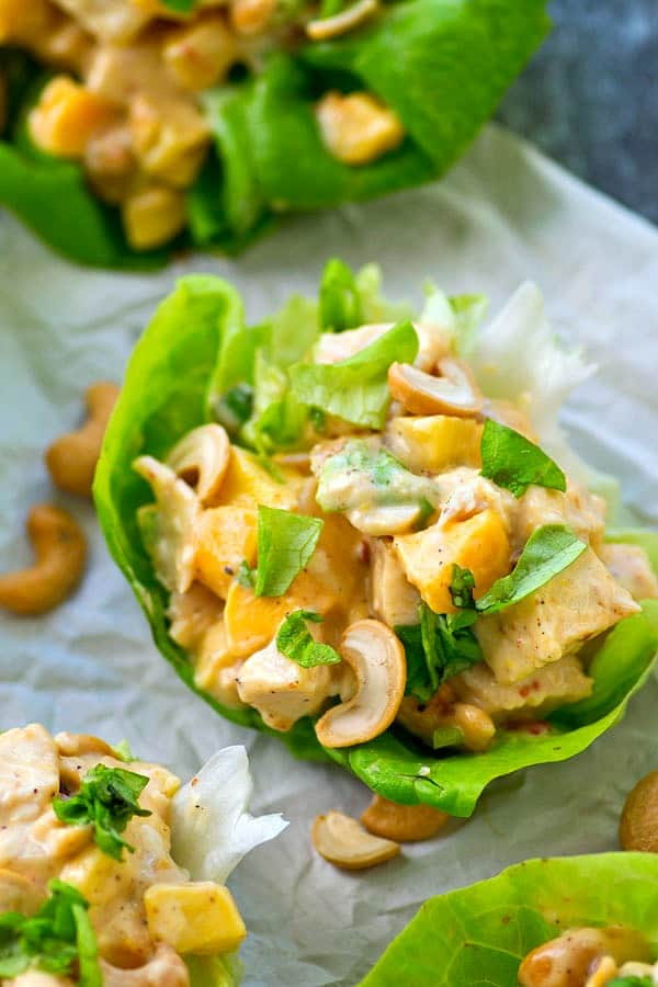 These kickin' chicken salad lettuce wraps are packed with the perfect balance of zingy chipotle flavors and sweet mango.---they're SO easy to throw together in less than 10 minutes!