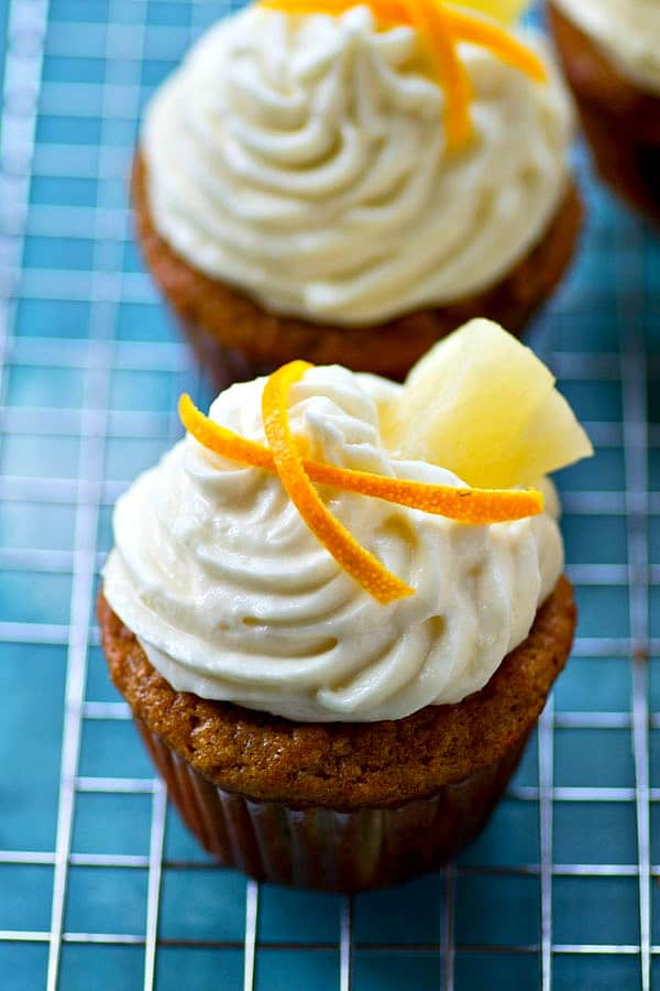 Spring in a cupcake! These pineapple banana cupcakes are ultimately soft and tropical-y inside and a citrus cream cheese frosting piped high on top makes them completely irresistible!