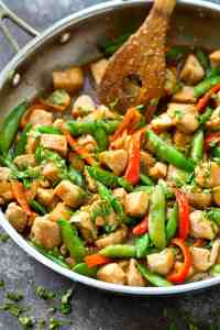 This easy one-pan chicken snap pea stir-fry skillet is packed with tons of pretty spring veggies and fresh ginger with a homemade Asian sauce makes it so flavorful!