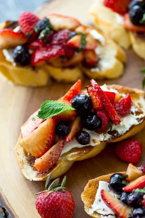 This mixed berry cream cheese breakfast bruschetta is unbelievably easy to put together for brunch and especially perfect for Mother's Day! The fresh trio of berries makes it so gorgeous.