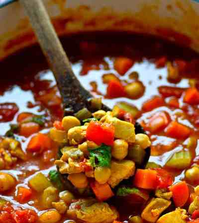 Packed with juicy chicken, tons of veggies and chickpeas, and cozy Moroccan spices, this one-pot Moroccan chicken chickpea soup is going to quickly become a dinner regular!