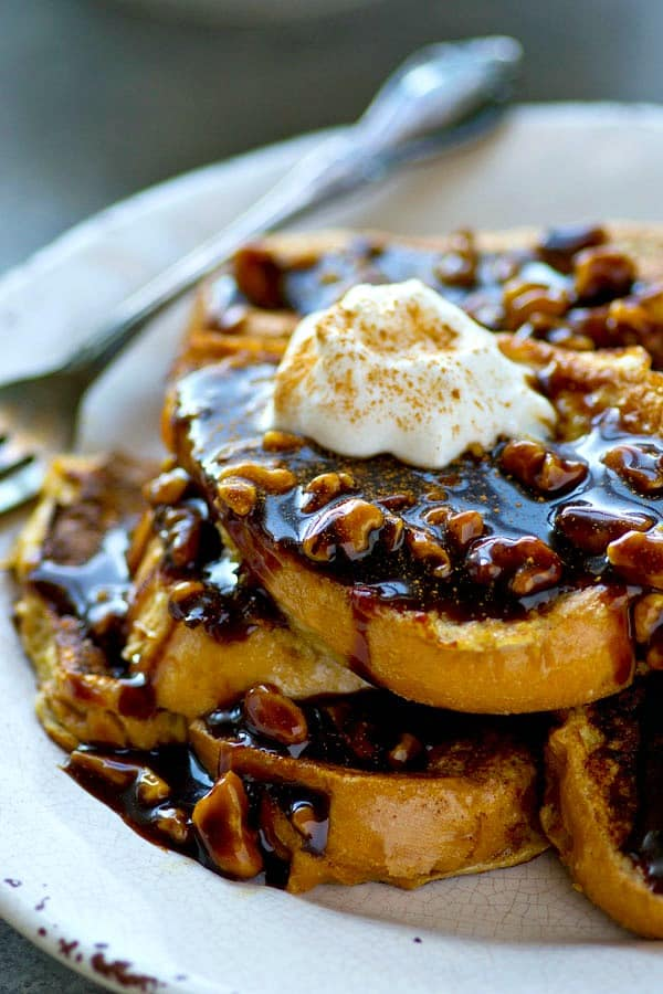 Sweet 'n' spiced gingerbread french toast is smothered with a sweet, gooey walnut caramel sauce for the ultimate holiday twist on french toast!