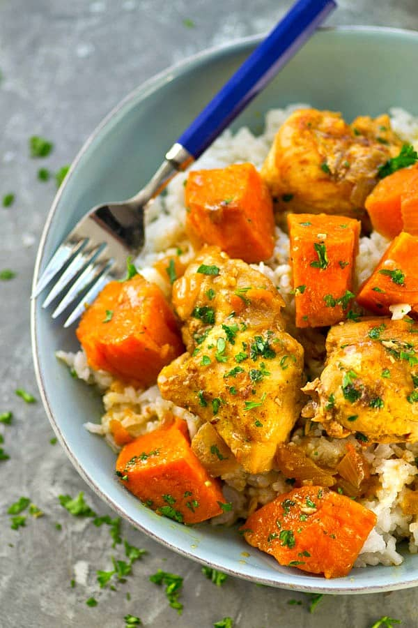 Sweet potatoes and chicken are slowly braised in a flavorful coconut milk curry sauce and served over a ton of fluffy coconut rice for a healthy and flavor-packed version of chicken curry!