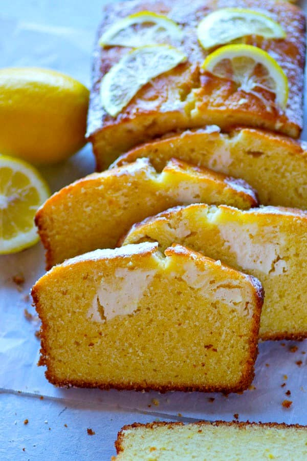 Swirled with a tangy cream cheese filling and packed with tons of lemon flavor, this beautiful lemon cream cheese swirl pound cake is perfect for spring and you'll NEVER believe how easy it is!
