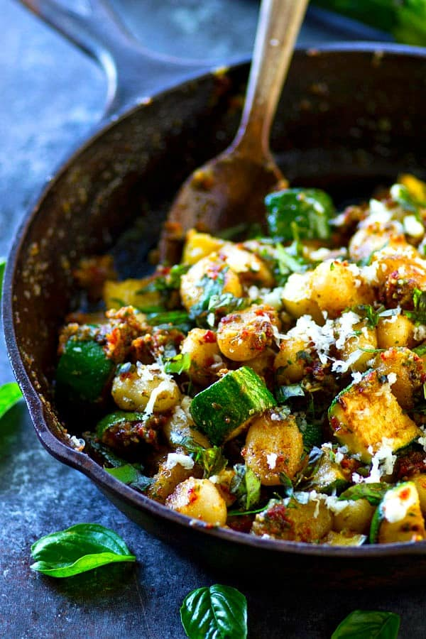 This sun-dried tomato pesto gnocchi is BIG on the flavor and the ease! The secret is in the homemade sun-dried tomato pesto and tender charred zucchini.