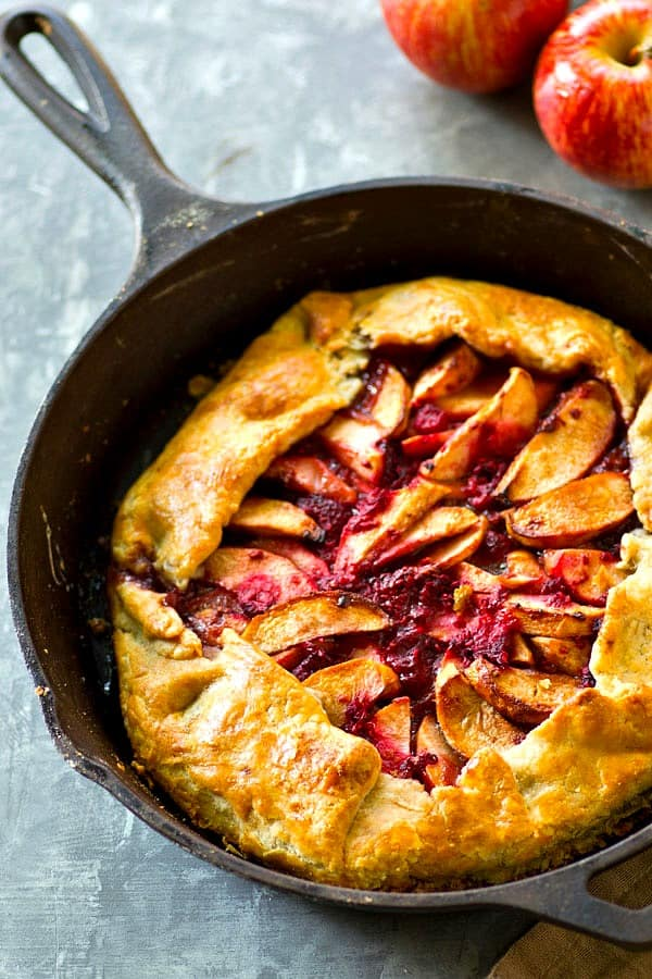 Sweet apples and tangy raspberries are a perfect match in this rustic skillet apple raspberry galette! So easy and impressive to throw together for a last minute dessert.