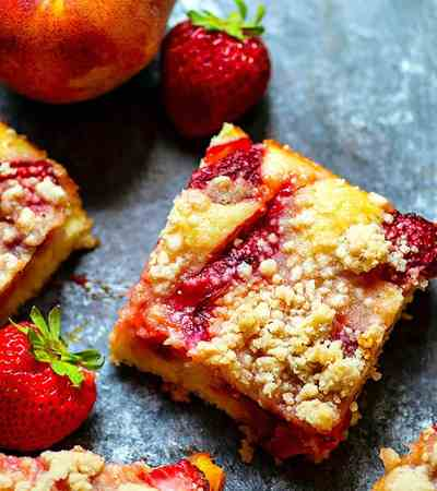 Strawberry Peach Crumb Buckle - Summer-fresh strawberries and peaches join forces in this streusel-covered strawberry peach crumb buckle that's a perfect summer coffee cake or dessert!