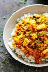 Charred sweet corn and tender zucchini cubes in an INSANELY flavorful coconut curry sauce piled over fluffy rice make this zucchini coconut curry one for the summer books!