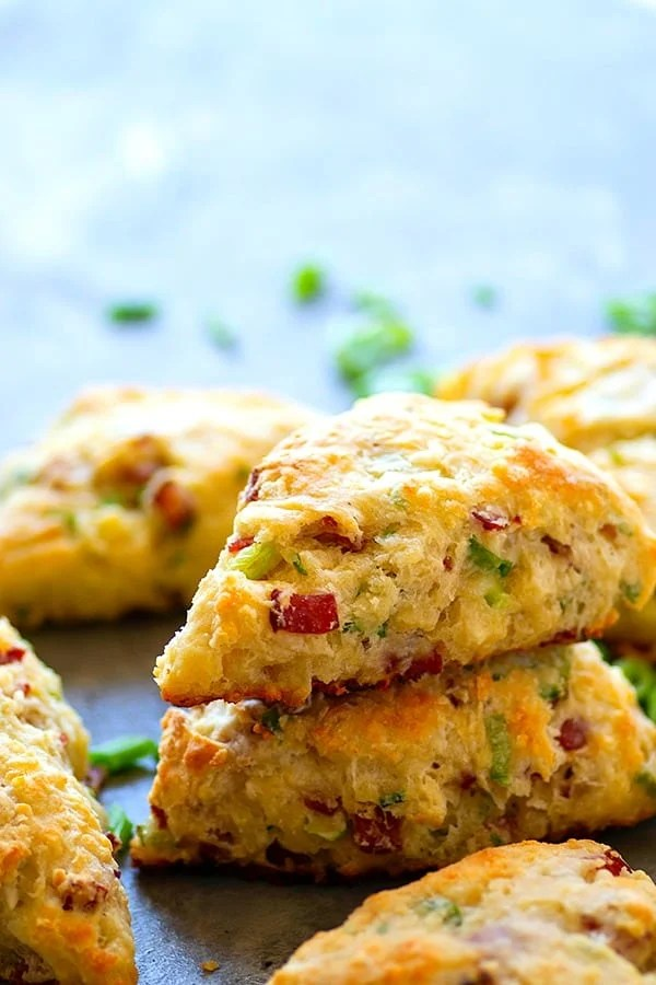 White Cheddar Bacon Scallion Scones - Sharp white cheddar, smoky bacon, and lots of scallions are the perfect flavor trio for these savory scones. - perfect for breakfast or alongside your favorite soup!
