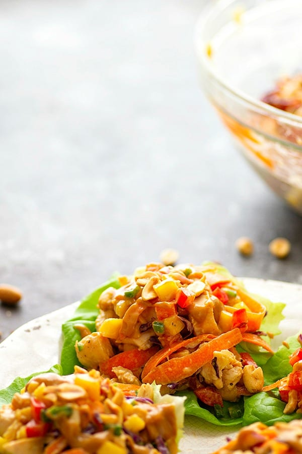 Spicy Peanut Thai Mango Chicken Lettuce Wraps - A creamy peanut sauce and spicy Thai flavors collide in these colorful mango chicken lettuce wraps that are a perfect lighter lunch or dinner!