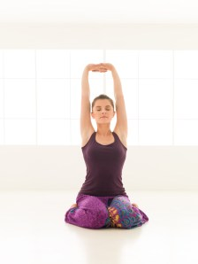 Woman seated for yoga.