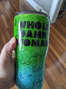 Tumbler, Whole Damn Woman logo, various types of boobs, over a green and blue glitter base
