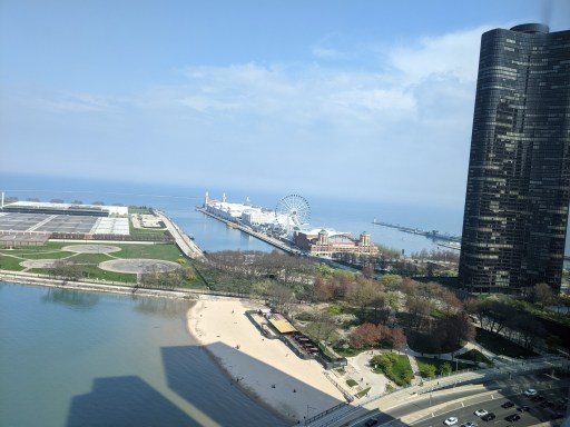 The view from the 27th floor of our hotel room on Lake Shore Drive shows the entire length of Navy Pier, Lake Pointe Tower, a beach, and a little traffic on Lake Shore.