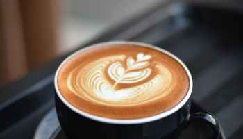 close up of coffee cup on table