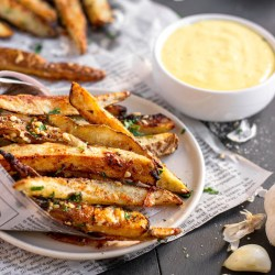 Whole30 Garlic Fries - Paleo, Gluten-free, Dairy-free. These amazing crispy fries can be cooked in the airfyer or oven.
