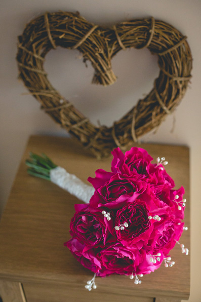 Striking fuschia bride's bouquet | Autumn wedding at Wolfscastle hotel by Whole Picture Weddings