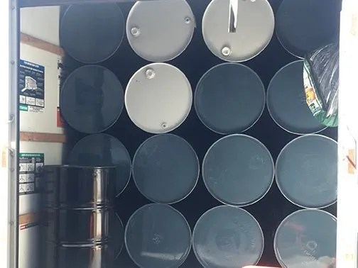 bulk hand sanitizer drums on truck