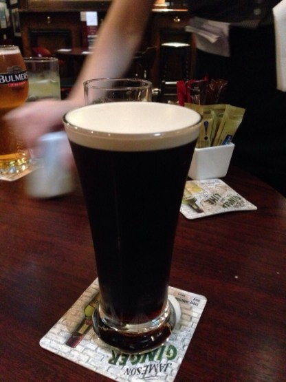 Enjoying a Guinness and watching HURLING!