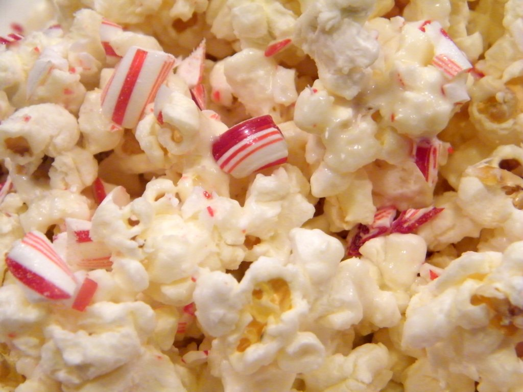 Delicious blend of flavors in this favorite holiday snack! White Chocolate Candy Cane Popcorn is quite addictive though, don't say I didn't warn you!