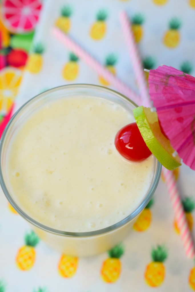 Tropical Baileys Colada, chocked full coconut, pineapple, banana, and rum flavors with the lovely addition of Baileys! This is an awesome summer cocktail.
