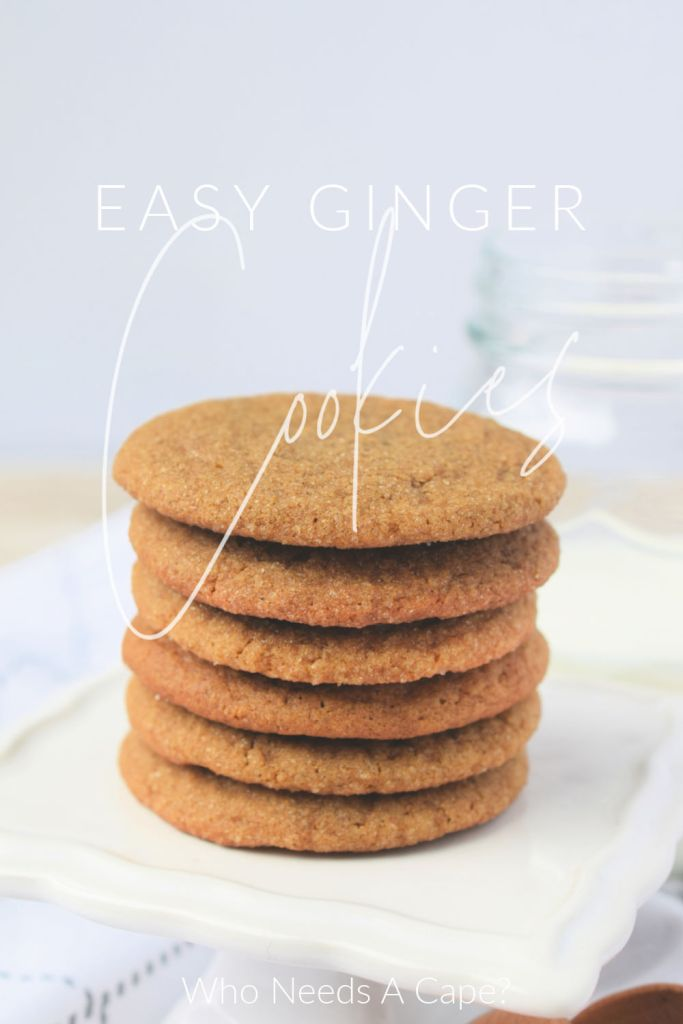 stack of six cookies on white dish with glass of milk in background