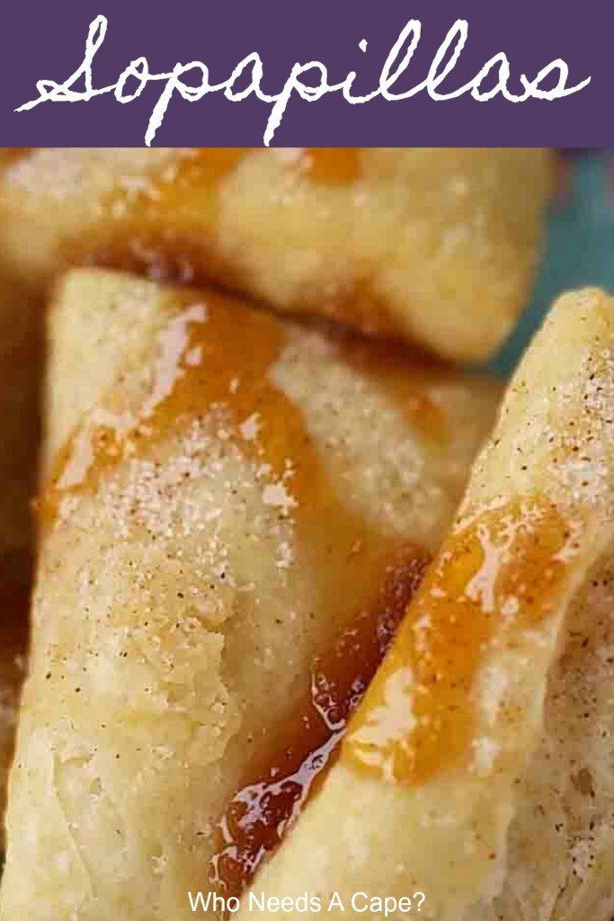 sopapillas on plate drizzled with honey and sprinkled with cinnamon sugar