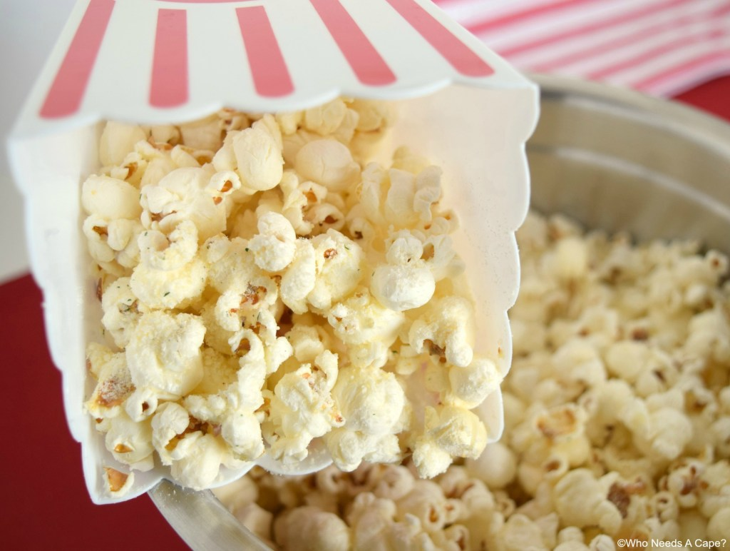 Make this incredibly snackable Garlic Parmesan Popcorn for your next movie night! Popcorn with drizzles of butter and pops of garlic and parmesan cheese!