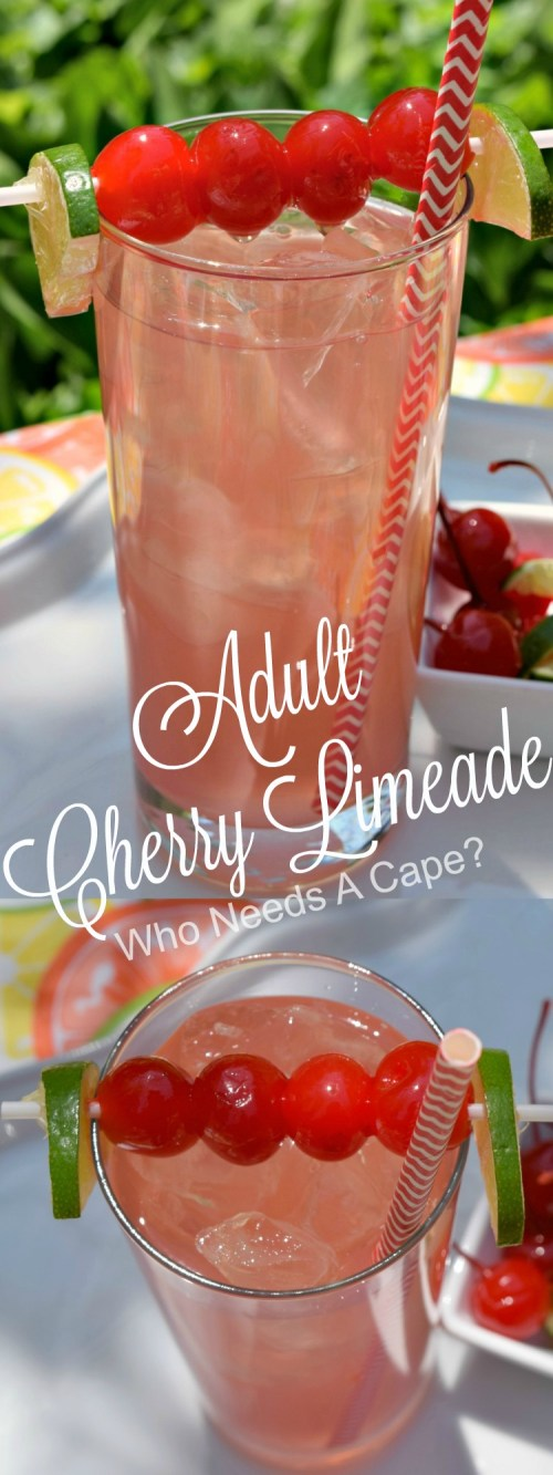 tall glass with adult cherry limeade inside with striped red straw and cherry and lime garnish on white plate outdoors