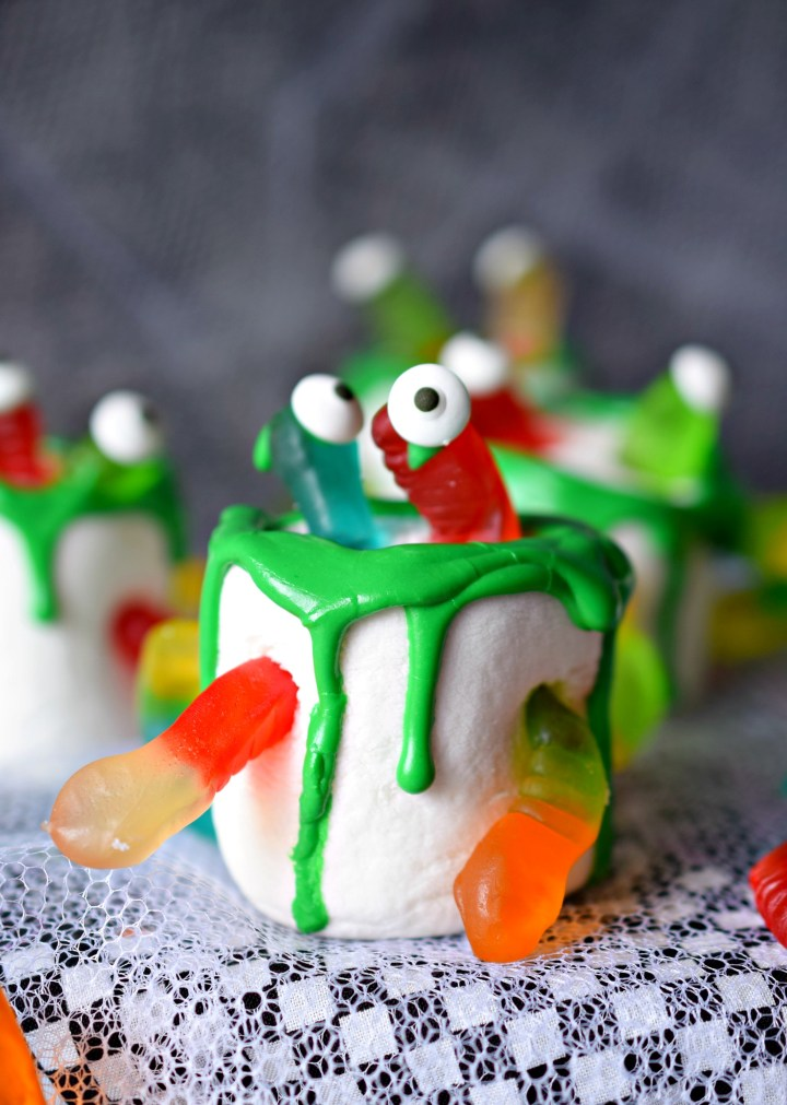 Jumbo marshmallows and gummy worms come alive in Wormy Marshmallow Monsters. This fun and ooey Halloween Treat is a great treat for parties!